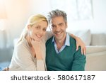 portrait of middle aged couple... | Shutterstock . vector #580617187
