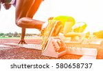 runners feet on starting blocks ... | Shutterstock . vector #580658737