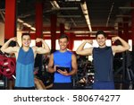 portrait of athletic men in gym | Shutterstock . vector #580674277