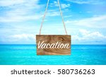 vacation on wooden hanging... | Shutterstock . vector #580736263
