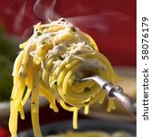 fresh hot  spaghetti  with cheese on fork  with vapor, closeup, square format - stock photo