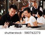 couple in restaurant  looking... | Shutterstock . vector #580762273