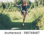 young woman happy jumping up... | Shutterstock . vector #580768687