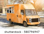 fast food truck on city street | Shutterstock . vector #580796947