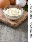Small photo of Aioli sauce and ingredients on wooden background