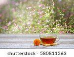tea glass and flower on wooden... | Shutterstock . vector #580811263