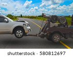 tow truck delivers the damaged...   Shutterstock . vector #580812697