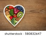healthy food in heart shaped... | Shutterstock . vector #580832647