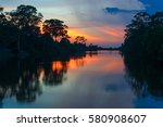 sunset along the banks of the... | Shutterstock . vector #580908607