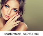 beautiful model girl with pink... | Shutterstock . vector #580911703