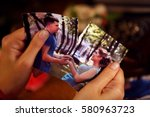 Small photo of Broken heart woman. Couple break up. Woman and man quarrel. Close up of female hands tearing family pictures.