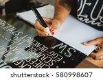 young woman writing cafe menu... | Shutterstock . vector #580998607