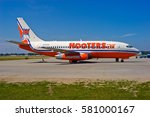Small photo of MYRTLE BEACH / USA - SEPTEMBER 2003 Short lived Hooters Air Boeing 737-228 ADV, N252TR, cn 23001 / 936 awaiting its next flight. Originally delivered to Air France in 1983.