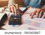 businessman using calculator...   Shutterstock . vector #581002867