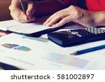 woman doing finance and writing ... | Shutterstock . vector #581002897
