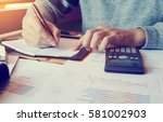 young man doing finance in home ... | Shutterstock . vector #581002903