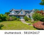 big custom made luxury house... | Shutterstock . vector #581042617