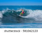 riding the waves. costa rica ... | Shutterstock . vector #581062123