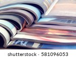 pile of magazines   colorful | Shutterstock . vector #581096053