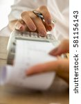Small photo of Accountant using adding machine to do the expenses balance, low angle view.