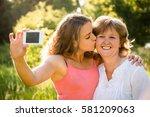 adult daughter kissing her...   Shutterstock . vector #581209063