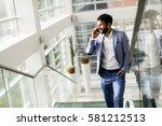 young businessman climbing... | Shutterstock . vector #581212513