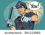 police officer cop with a baton.... | Shutterstock .eps vector #581223883