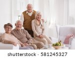 group of happy seniors at day... | Shutterstock . vector #581245327
