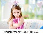 moody little girl wearing... | Shutterstock . vector #581281963