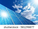 group of solar panels on a blue ...
