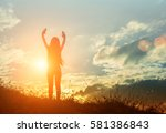 silhouette of free cheering... | Shutterstock . vector #581386843