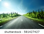 road in forest  sweden | Shutterstock . vector #581427427