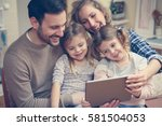 happy family spending time at... | Shutterstock . vector #581504053