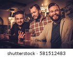 cheerful old friends drinking... | Shutterstock . vector #581512483