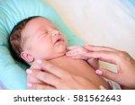 after childbirth newborn baby... | Shutterstock . vector #581562643