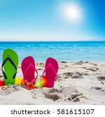 flip flops on the sand in the... | Shutterstock . vector #581615107