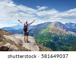 a man stands on a top of the... | Shutterstock . vector #581649037