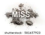 Small photo of The word miss written in dirt, dust, ash as pageant, contest, girl, missing, lost person, grief, sorrow, paradox, fail, ugly, dirty concept background