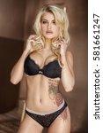beautiful sexy caucasian blonde ... | Shutterstock . vector #581661247
