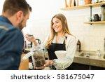 cute female barista giving...   Shutterstock . vector #581675047