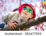 a smiling toddler boy in a... | Shutterstock . vector #581677543