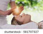 Small photo of Woman having reiki healing treatment , alternative medicine concept.