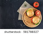 craft beef burgers on round... | Shutterstock . vector #581788327