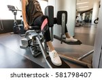 Small photo of Girl is exercising at gym, playing adductor, abductor leg, leg exercising