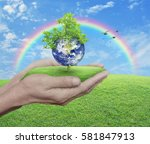 planet and tree in human hands... | Shutterstock . vector #581847913