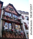 Small photo of STRASBOURG, FRANCE - DECEMBER 11, 2011: Traditional Alsatian house decorated for Christmas. The Petite France area, historic city centre, is and UNESCO World Heritage Site.