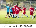 boys kicking football on the... | Shutterstock . vector #581883607