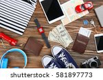 traveller's accessories on... | Shutterstock . vector #581897773