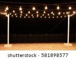 garlands of lamps on a wooden... | Shutterstock . vector #581898577
