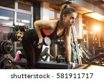 sporty girl weight lifting in...   Shutterstock . vector #581911717